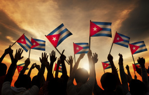 Silhouettes of People Holding Flag of Cuba