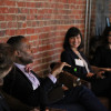 Sarah Greenberger L'05, Todd A. Cox L'92, and Premal Dharia L'03 speak during a panel m...