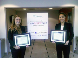 Lauren Saltiel and Christina Wong, both 2L students, with their awards.