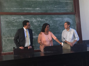 Wendell Pritchett (left) and Fernando Chang-Muy (right) in discussion with Professor Dagniselys Toledano-Cordero (center) during the group's visit to the University of Havana Law School.