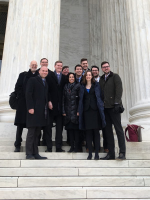 Students and faculty from Penn Law's Supreme Court Clinic stand on the steps of the Supreme Court.