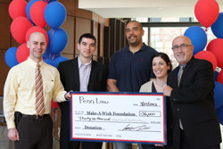 Prof. Adam Grant (far left) and Penn Law students present a check for $36,000 to Make-A-Wish® Philadelphia and Susquehanna Valley President & CEO Dennis Heron (right).