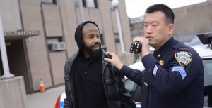 Justin Thomas, left, was arrested for filming the exterior of an NYPD precinct.