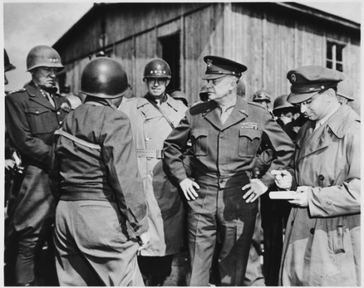 General Eisenhower at Ohrdruf (U.S. Holocaust Museum, courtesy of Felice Grad)